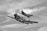 Two Curtiss P-40 Warhawks in Flight Near Nampa  Idaho