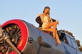 1940's Style Aviator Pin-Up Girl Posing with a Vintage T-6 Texan Aircraft