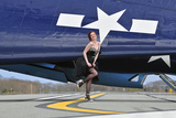 1940's Style Pin-Up Girl in Cocktail Dress Posing in Front of a Tbm Avenger
