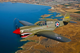A Curtiss P-40E Warhawk in Flight Near Chino  California