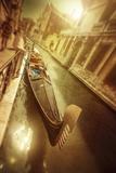 Gondola in Venetian Canal at Sunset  Venice  Italy