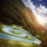 Winding Road in a Forest of Dolomite Alps at Sunset  Northern Italy