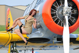 1940's Style Pin-Up Girl Posing on a T-6 Texan Training Aircraft