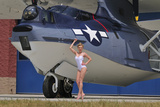 Retro Pin-Up Girl Posing with a World War II Era Pby Catalina Seaplane
