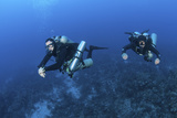 Technical Divers with Equipment Swimming in Caribbean Reef