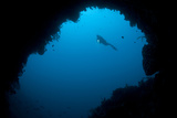 A Diver Explores a Cavern in Gorontalo  Sulawesi  Indonesia