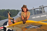 1940's Style Pin-Up Girl Lying on a T-6 Texan Training Aircraft