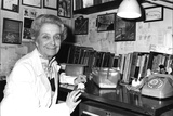 Rita Levi-Montalcini Sitting at a Desk