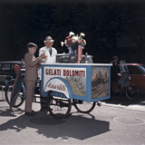 An Ice Cream Man Giving a Cone To a Child
