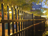 Light Reflects Off a Metal Fence at Night in Downtown Saint Paul  Minnesota