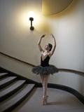A Ballerina Dancing En Pointe in a Stairwell