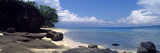 An Idyllic Cove Overlooks a Turquoise Lagoon on a Tropical Island