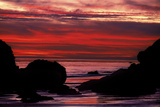 Silhouetted Rock Formations During a Dramatic Fiery Sunset at El Matador Beach