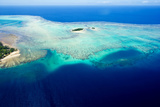 Coral Reefs Stretch Out from the Shoreline of a Tropical Island