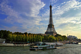 A Scenic View of the Eiffel Tower and a Ferry in the Seine River