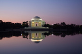 The Jefferson Memorial and its Mirror Reflection Cast on the Tidal Basin at Sunrise