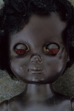 Head and Shoulders of Modern Plastic Black Girl Doll Slightly Scratched and Soiled Lying
