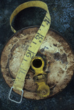 Groundsmans Measuring Tape in Well Worn Metal Case with Brass Winding Handle Lying