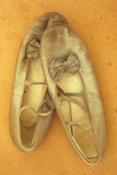 Pair of Ballet or Dancing Shoes Once White But Now Used and Grubby Sitting One Face Down