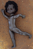 Modern Plastic Black Girl Doll Slightly Scratched and Soiled Lying