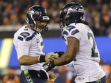 NFL Super Bowl 2014: Feb 2  2014 - Broncos vs Seahawks - Russell Wilson  Marshawn Lynch