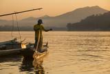 Man Reeling in Fishing Net on Mekong River  Luang Prabang  Laos  Indochina  Southeast Asia  Asia