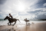 Two Young Boys and their Horses Play in the Ocean in Nihiwatu