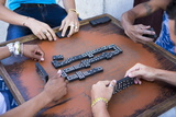 Local Men Playing Dominos on a Street in Cienfuegos  Cuba  West Indies  Central America