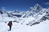 Sherpa Guide Walking over Cho La Pass with Ama Dablam on Left and Arakam Tse on Right Side