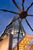 Low Angle View at Dusk of Mori Tower and Maman Spider Sculpture