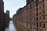 Red Brick Warehouses Overlook a Canal in the Speicherstadt District