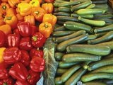 Red Peppers  Yellow Peppers and Courgettes on a Market Stall