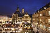Christmas Fair on Schillerplatz Square with Stiftskirche Church
