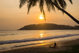 Woman Sitting on Mirissa Beach Watching the Sun Set