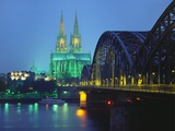 Hohenzollernbrucke and the Cathedral Illuminated at Night  Cologne  Germany