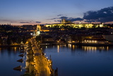 Charles Bridge over the River Vltava and Little Quarter Illuminated at Dusk