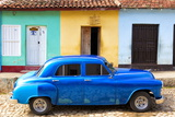 Bright Blue Vintage American Car Parked in Front of Colourful Painted Colonial Houses