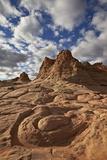 Sandstone Swirl under Clouds