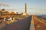 Promenade and Lighthouse Faro De Maspalomas in the Evening