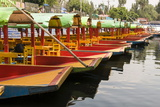 Line of Colourful Boats at the Floating Gardens in Xochimilco