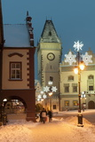 Snow-Covered Christmas Decorated Lamps and Gothic Town Hall