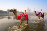 Man and Boy Riding Camels in the Yamuna River in Front of the Taj Mahal Papier Photo par Gavin Hellier
