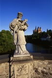 Statue on the Old Lahn-Bridge and a Cathedral in Limburg  Germany