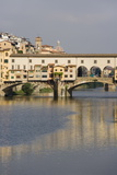 The Ponte Vecchio Reflected in the River Arno in Florence  Tuscany  Italy