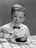 1960s Boy Wearing Bow Tie Eating Pie Dessert with Fork