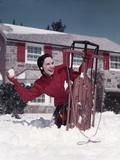 1950s Woman Hiding Behind Sled Throwing Snowball Front Stone House