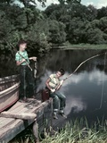 1950s Two Boys Fishing in Lake from Dock Outdoor