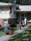 1950s Wife Watching Man Coming Home Arms Extended to Son and Daughter