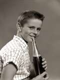 1950s Boy Drinking Carbonated Beverage from Soda Pop Bottle with Straw