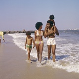 1970s African-American Family of Four Walking on Beach